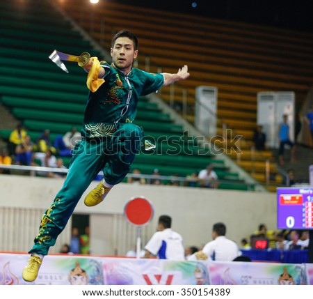 JAKARTA, INDONESIA - NOVEMBER 16, 2015: Melvin Tan of Australia performs the movements in the men's Daoshu event at the 13th World Wushu Championship 2015 at the Istora Senayan Stadium. - stock photo