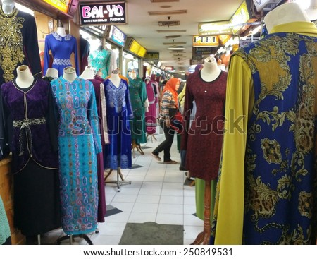 JAKARTA, INDONESIA - SEPT 13, 2014 : Rows of colorful batik pattern on sale in Jakarta, Indonesia. - stock photo