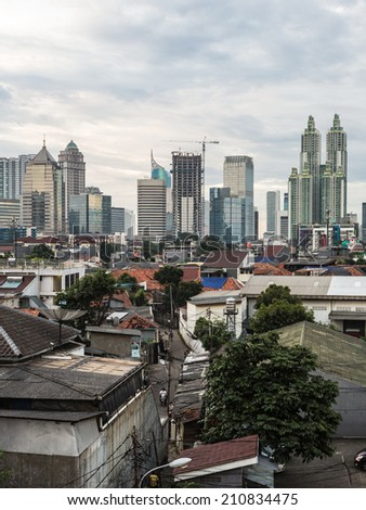 Jakarta, the capital city of Indonesia, is a mixed a modern tall buildings and older village right in the center of the city. - stock photo