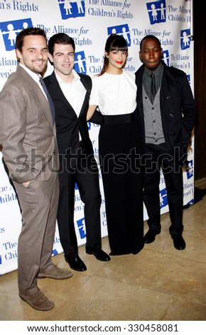 Jake Johnson, Hannah Simone, Max Greenfield and Lamorne Morris at the Alliance for Children's Rights Dinner Honoring Kevin Reilly held at the Beverly Hilton Hotel in Los Angeles, USA on March 1, 2012. - stock photo