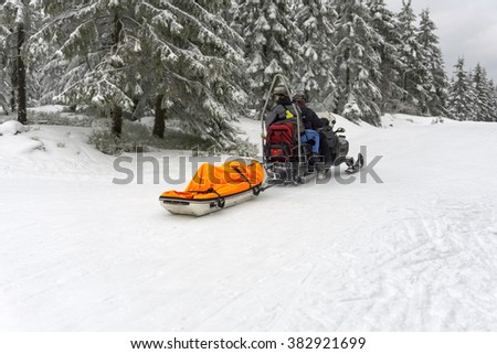 JAKUSZYCE, POLAND - February 19, 2016: Ski patrol evacuate an injured skier