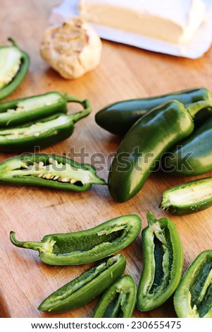 jalapeno popper ingredients cutting board vertical - stock photo