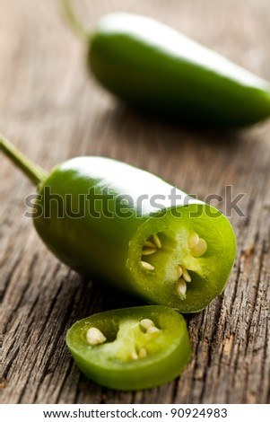 Jalapenos Chili Peppers on kitchen table - stock photo