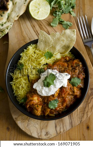 Jalfrezi Indian chicken curry with pilau rice - stock photo