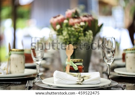 Jam and wooden spoon as part of table decoration