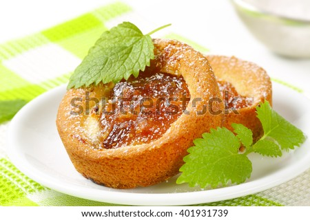 Jam biscuits sprinkled with icing sugar - stock photo