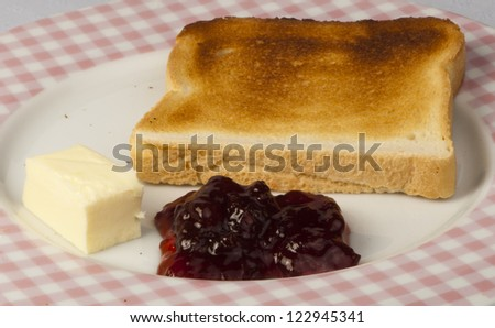Jam, butter and toast close up . - stock photo
