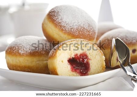 Jam filled Bismarck doughnuts closeup - stock photo