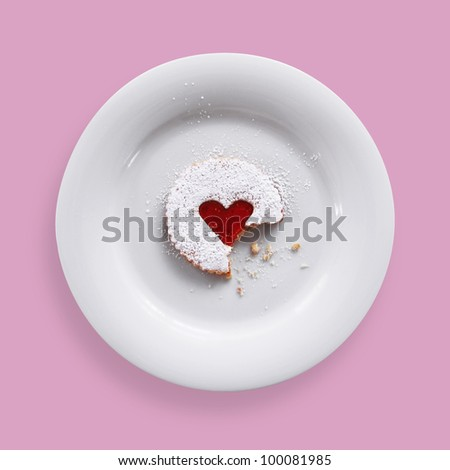 Jam heart cookie on a plate - stock photo