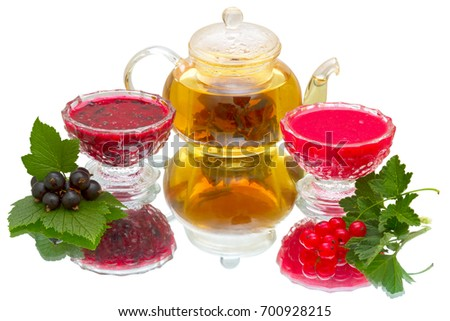 Jam of red and black currant, fresh berry and  teapot with green tea.
