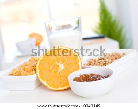 Jam, orange, cornflakes and milk / Fast and delicious breakfast - stock photo