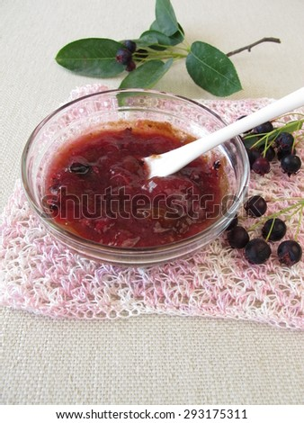 Jam with juneberries - stock photo