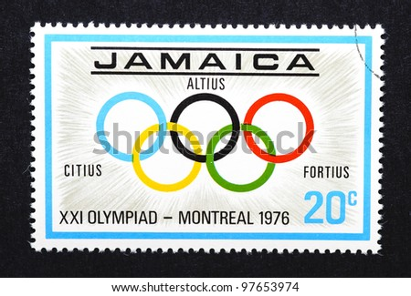 "JAMAICA – CIRCA 1976: A postage stamp printed in Jamaica showing an image of the Olympic rings with the latin words ""altius, citius, fortius"", circa 1976."
