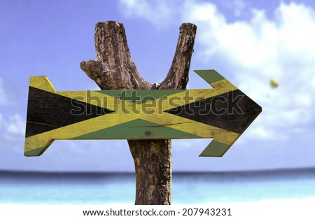 Jamaica wooden sign with a beach on background  - stock photo