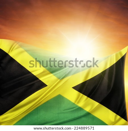 Jamaican flag in front of bright sky - stock photo