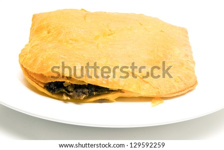 Jamaican style beef patty pattie fried pastry food - stock photo