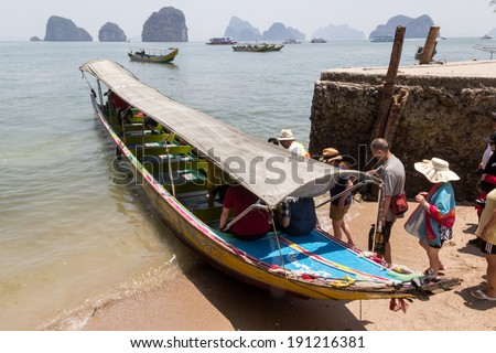 James bond island, Thailand - MARCH 28: unidentified people get on long tail boat from James bond island to ferry on March 28,2014