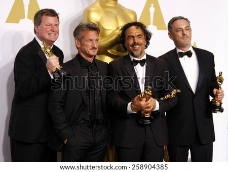 James W. Skotchdopole, Alejandro Gonzalez Inarritu, John Lesher and Sean Penn pose in the press room during the 87th Annual Academy Awards at Loews Hollywood Hotel on February 22, 2015 in Hollywood. - stock photo