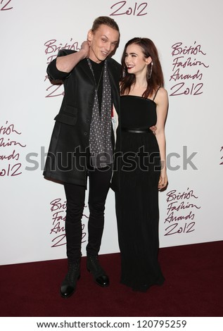 Jamie Campbell Bower and Lily Collins arriving for The British Fashion Awards 2012 held at The Savoy, London. 27/11/2012 Picture by: Henry Harris - stock photo