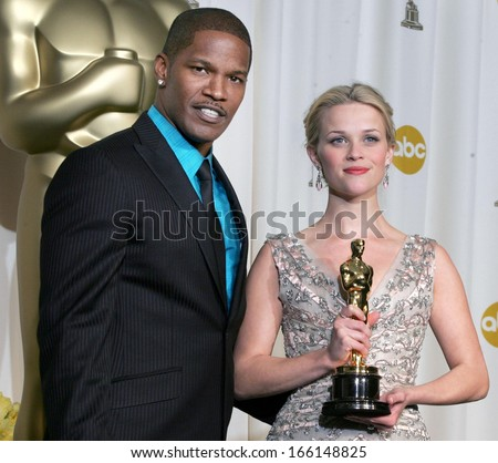 Jamie Foxx, Reese Witherspoon in the press room for OSCARS 78th Annual Academy Awards, The Kodak Theater, Los Angeles, CA, Sunday, March 05, 2006 - stock photo