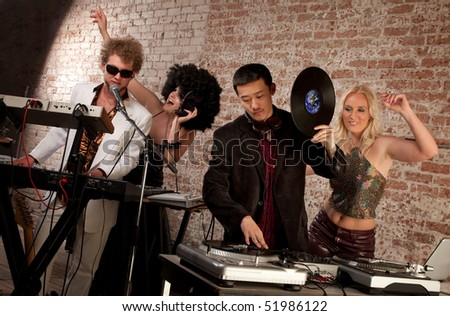 Jammin at a 1970s Disco Music Party - stock photo