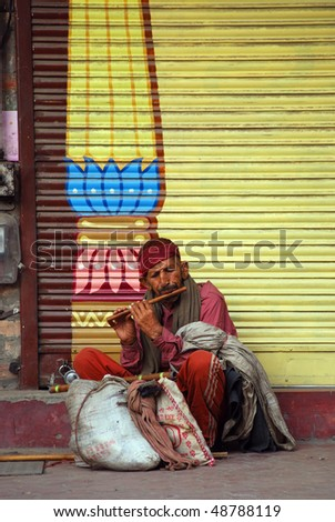 JAMMU, INDIA - OCT 16: Pilgrim waiting for entering to Raghunath temple at October 16, 2009 in Jammu, India