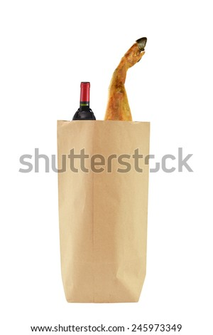 Jamon cured ham in shopping bag with bottle of red wine isolated on white background - stock photo