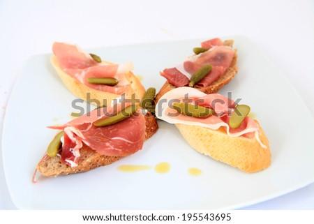 Jamon. Serrano ham, prosciutto served on bread. Tapas food - stock photo