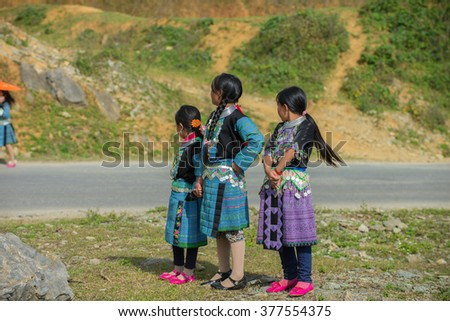 Jan 10, 2016: H'mong children in Son La, Vietnam. In time Hmong New Year at the end of the Lunar year, they often wear the most beautiful costumes, the most brilliant, from young children to adults.