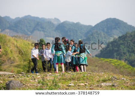 Jan 11, 2016: H'mong children in Son La, Vietnam. In time Hmong New Year at the end of the Lunar year, they often wear the most beautiful costumes, the most brilliant, from young children to adults. - stock photo