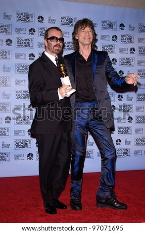 Jan 16, 2005; Los Angeles, CA: DAVE STEWART (left) & MICK JAGGER at the 62nd Annual Golden Globe Awards at the beverly Hilton Hotel. - stock photo