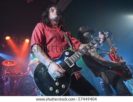 JANESVILLE, WI - JULY 16: Alex Grossi (Beautiful Creatures, Quiet Riot) performs with Adler's Appetite on their 2010 U.S. tour on July 16, 2010 in Janesville, WI. - stock photo