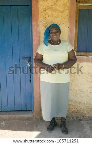 JANUARY 2007 - A Kenyan woman smiles in front of Pepo La Tumaini Jangwani, HIV/AIDS Community Rehabilitation Program, Orphanage & Clinic.  Nairobi, Kenya, Africa - stock photo