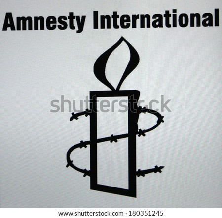 "JANUARY 27, 2014 - BERLIN: the logo of the non governmental organization ""Amnesty International"". - stock photo"