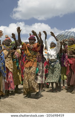 JANUARY 2007 - Grandmothers, who are the caretakers of their children and grandchildren who are infected with HIV/AIDS, dance at Pepo La Tumaini Jangwani, Nairobi, Kenya, Africa - stock photo