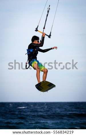 "January 18, 2015.  ""Lord of the Wind Baja"", Los Barriles, Mexico. A kiteboarder performs a stunt and catches air during a professional kiteboarding competition on the Sea of Cortez."