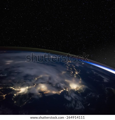 Japan at night from space with stars above. Elements of this image furnished by NASA.  - stock photo