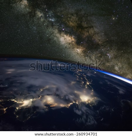 Japan at night from space with the Milky Way above. Elements of this image furnished by NASA.  - stock photo