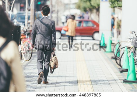 Japan businessman walking to work . vintage tone .