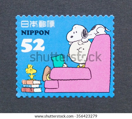 JAPAN - CIRCA 2014: a postage stamp printed in Japan showing an image of Peanuts cartoon characters, circa 2014.  - stock photo