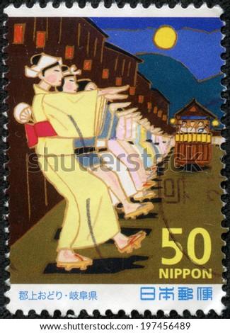 JAPAN - CIRCA 2000: A stamp printed in Japan shows Folk dance, circa 2000 - stock photo