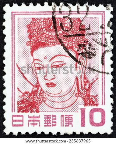 JAPAN - CIRCA 1954: A stamp printed in Japan shows Kannon Bosatsu (detail of wall painting, Horyu Temple), circa 1954.  - stock photo