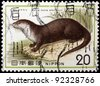 JAPAN - CIRCA 1977: A stamp printed in Japan shows Lutra lutra whiteleyi, circa 1977 - stock photo