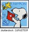 JAPAN - CIRCA 2000: A stamp printed in Japan shows Snoopy, circa 2000  - stock
