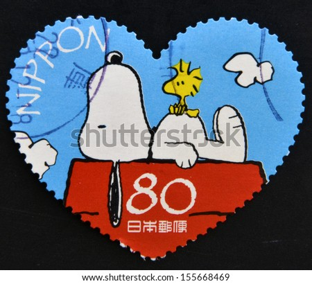 JAPAN - CIRCA 2000: A stamp printed in Japan shows Snoopy, circa 2000  - stock photo