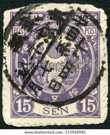 JAPAN - CIRCA 1877: A stamp printed in Japan shows Sun, Kikumon and Kiri Branches, circa 1877 - stock photo