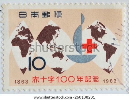 JAPAN - CIRCA 1963 : postage stamp printed in Japan shows the century anniversary of world map International red cross, circa 1963 - stock photo