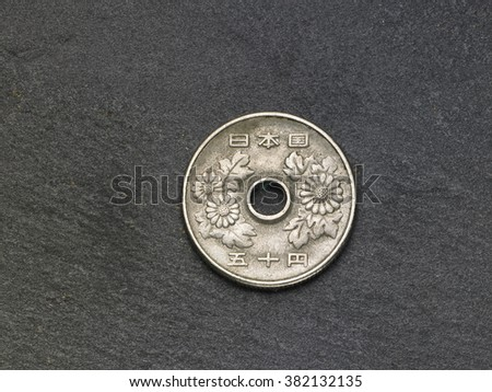 japan coin on the black slate