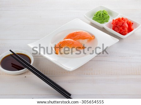 Japan cuisine. Sushi on a gete over wooden background