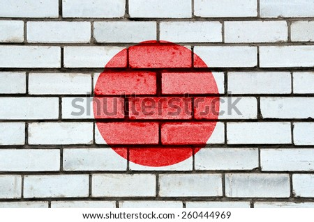 Japan flag painted on old brick wall texture background